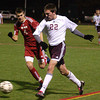 Abington's Harry Horn sends the ball into the middle.