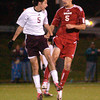 Abington's Chris Tracey and Wilson's Adam Bainbridge battle for a header.