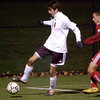 Abington's Kurt Howard tries to dig the ball out of a corner and away from Wilson's Rocky Elgogan.