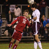 Abington's Chris Tracey gets to a header before Wilson's Mack Trexler.