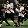 Wood's Andrew Guckin runs to the outside.<br /> <br /> Bob Raines 12/10/10