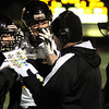 Archbishop Wood head coach Steve Devlin sends in a play with Sean Cain and Joe Santospago during the semi-final game with Allentown Central Catholic.<br /> Bob Raines 12/10/10
