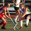 FH_Wood Fleet 7345_Archbishop Wood's Lauren Bauer checks Fleetwood's Alyson Landis.    Bob Raines 11.08.11