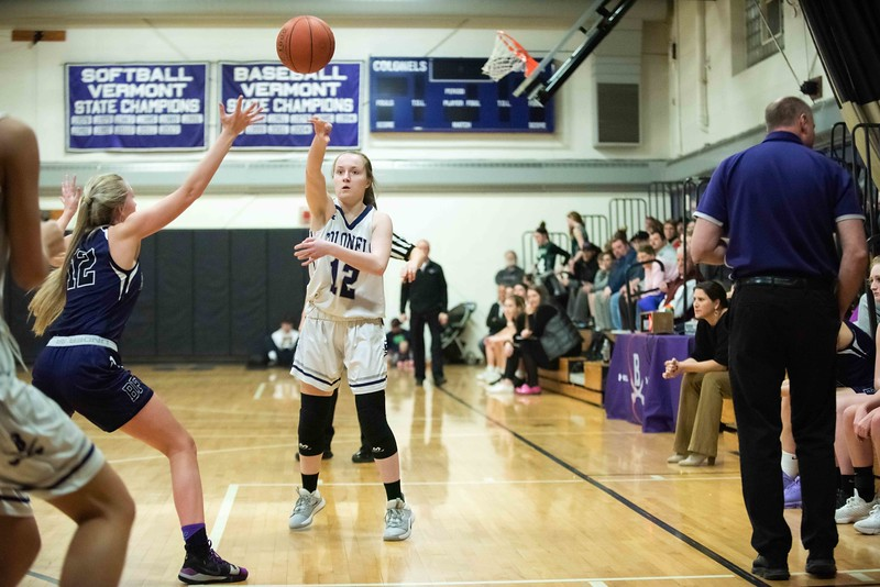 KELLY FLETCHER, REFORMER CORRESPONDENT -- Bellows Falls' Taylor Goodell (#12) tries to block a pass by Brattleboro's Kiki Mcary during their match up on the court Wednesday night at BUHS.