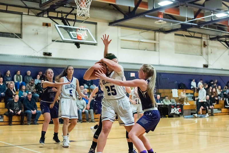 KELLY FLETCHER, REFORMER CORRESPONDENT -- Lauryn Sargent is engulfed by Bellows Falls defenders, Taylor Goodell and Molly Potter (behind), as she tried to maintain possession of the ball for the Colonels.