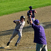 KRISTOPHER RADDER - BRATTLEBORO REFORMER<br /> Brattleboro's Evan Finnell rounds third to score as the ball gets away from Mount Anthony Union during a baseball game at Brattleboro Union High School on Wednesday, May 9, 2018.