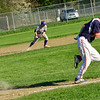 KRISTOPHER RADDER - BRATTLEBORO REFORMER<br /> Brattleboro's Ben Betz digs deep to get Mount Anthony Union's Noah Loomis out at first during a baseball game at Brattleboro Union High School on Wednesday, May 9, 2018.
