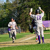 KRISTOPHER RADDER - BRATTLEBORO REFORMER<br /> Brattleboro's Chris Frost runs hard into home during a baseball game against Mount Anthony Union at Brattleboro Union High School on Wednesday, May 9, 2018.