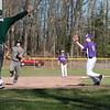 The Rebels' Trevor Plimpton rounds third base (and scores) during their game in Bellows Falls on Wednesday, April 19th.  The Rebels won, 4-2.  KELLY FLETCHER, REFORMER CORRESPONDENT