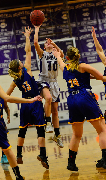 KRISTOPHER RADDER - BRATTLEBORO REFORMER<br /> Bellows Falls' Halle Dickerson takes a jump shot while being covered by Sydney Alexander and Ava Cochran during the Girls Varsity's first round of playoffs at Bellows Falls Union High School on Wednesday, Feb. 28, 2018.