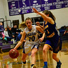 KRISTOPHER RADDER - BRATTLEBORO REFORMER<br /> Bellows Falls' Halle Dickerson tries to get around Lamoille's Cora Bourdeau during the Girls Varsity's first round of playoffs at Bellows Falls Union High School on Wednesday, Feb. 28, 2018.