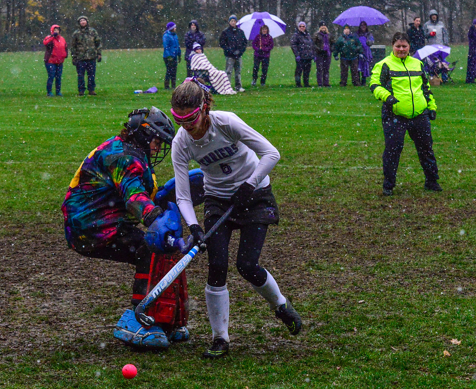 . Bellows Falls\' Molly Kelly gets around Montpelier\'s goalie Emily Bashara during a field hockey playoff game at Bellows Falls Union High School on Thursday, Oct. 27, 2016. Kristopher Radder / Reformer Staff