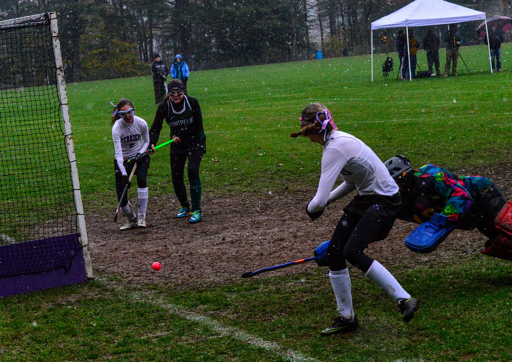 . Bellows Falls\' Molly Kelly gets the assist as she passes the ball to her teammate during a field hockey playoff game at Bellows Falls Union High School on Thursday, Oct. 27, 2016. Kristopher Radder / Reformer Staff