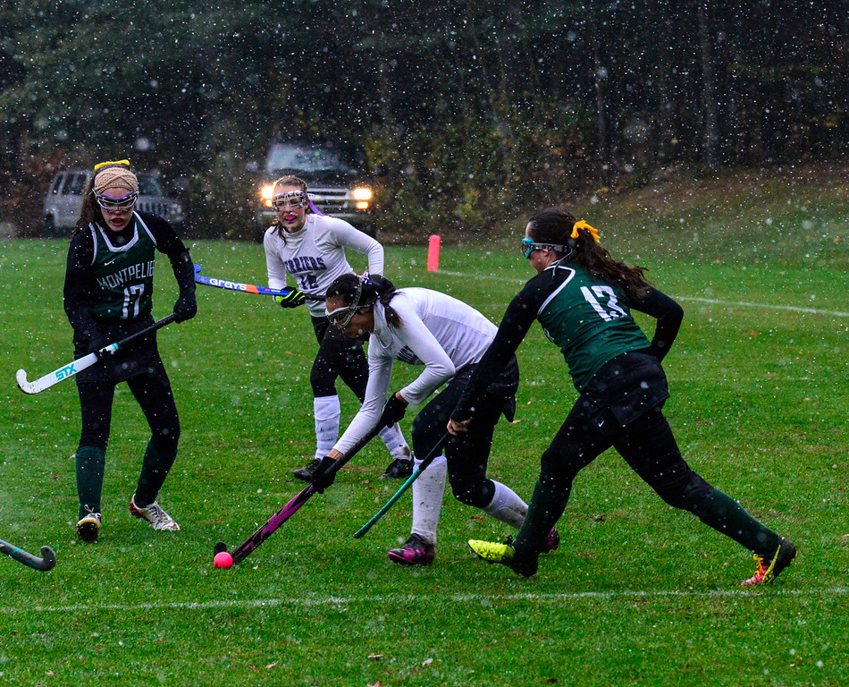. Bellows Falls\' Leia Robinson tries to get around Montpelier\'s defense during a field hockey playoff game at Bellows Falls Union High School on Thursday, Oct. 27, 2016. Kristopher Radder / Reformer Staff