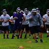 KRISTOPHER RADDER — BRATTLEBORO REFORMER<br /> Bellows Falls Union High School's defensive coordinator runs through some drills during practice on Tuesday, Aug. 13, 2019.