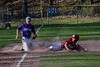Rutland's Reece de Castro slides into third as the ball gets away from Bellows Falls' shortstop Jacob Streeter during a baseball game on Thursday, April 21, 2016, at Bellows Falls Union High School. Kristopher Radder / Reformer Staff