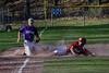 Rutland's Reece de Castro slides into third as the ball gets away from Bellows Falls' shortstop Jacob Streeter during a baseball game on Thursday, April 21, 2016, at Bellows Falls Union High School. Kristopher Radder / Reformer Staff