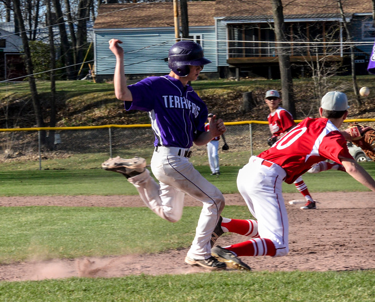 Bellows Falls Jacob Streeter makes it to first Rutland's first baseman Connor Munukka could get the ball during a baseball game on Thursday, April 21, 2016, at Bellows Falls Union High School. Kristopher Radder / Reformer Staff
