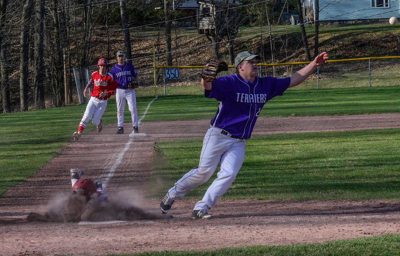 Rutland's Jacob Godfrey slides into home as the ball gets away from Bellows Falls' Brady Illingworth during a baseball game on Thursday, April 21, 2016, at Bellows Falls Union High School. Kristopher Radder / Reformer Staff