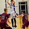 KRISTOPHER RADDER - BRATTLEBORO REFORMER<br /> Bellows Falls' Cam Joy takes a jump shot while being covered by Black River during a boys' varsity basketball game at Bellows Falls Union High School on Monday, Jan. 16, 2017.