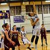KRISTOPHER RADDER - BRATTLEBORO REFORMER<br /> Bellows Falls' Shane Clark hooks the ball in during a boys' varsity basketball game at Bellows Falls Union High School on Monday, Jan. 16, 2017.