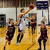 KRISTOPHER RADDER - BRATTLEBORO REFORMER<br /> Bellows Falls' Cam Joy leaps past Black River's Ryan Boyle during a boys' varsity basketball game at Bellows Falls Union High School on Monday, Jan. 16, 2017.