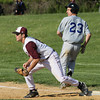 Bensalem's Ryan Amerman just beats the throw to Abington first baseman Trey Guaglionona.