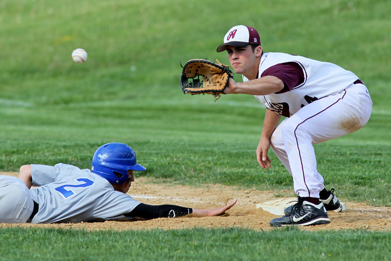 The throw to Abington first baseman Trey Guaglionona doesn't arrive in time to pick off Bensalem runner Chris Kilcoyne.