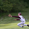 Abington left fielder Jack Larini dives for a long Bensalem foul ball but can't get to it.