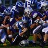 KRISTOPHER RADDER — BRATTLEBORO REFORMER<br /> Brattleboro's defense brings down U32's Nathan LaRosa during a football game at Brattleboro Union High School on Friday, Sept. 13, 2019.