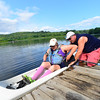 KRISTOPHER RADDER - BRATTLEBORO REFORMER<br /> Chris Duguay helps Bethany Duguay get into her kayak before the start of the first Brattle Paddle event held in Brattleboro, Vt., on Sunday, July 23, 2017.