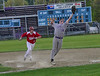 Brattleboro's Conor Hiner makes a leaping catch and then tries for a double play but Rutland's Jacob Clark-Trapana makes it back to first safely during Thursday's baseball game at Brattleboro Union High School. Kristopher Radder / Reformer Staff