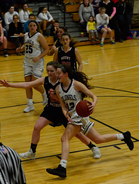 KRISTOPHER RADDER - BRATTLEBORO REFORMER<br /> Brattleboro's Hailey Derosia tries to run past Anna Iannotti during a varsity basketball game at Brattleboro Union High School on Monday, Feb. 12, 2018.