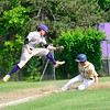 KRISTOPHER RADDER - BRATTLEBORO REFORMER<br /> Brattleboro's Ben Betz leaps into the air as Essex's Ryan Young makes it safely to third during a division 1 playoff game at Brattleboro Union High School on Friday, June 1, 2018.