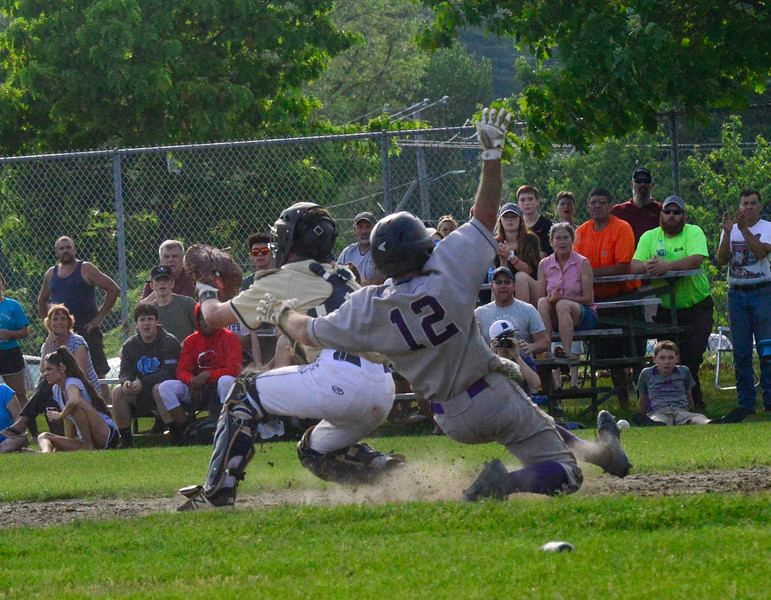 KRISTOPHER RADDER - BRATTLEBORO REFORMER<br /> Brattleboro's Tyler Millerrick slides into home for the first score of the game during a division 1 playoff game at Brattleboro Union High School on Friday, June 1, 2018.