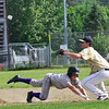 KRISTOPHER RADDER - BRATTLEBORO REFORMER<br /> Brattleboro's Tyler Millerrick slides into first before Essex's Garret Somerset could get the ball during a division 1 playoff game at Brattleboro Union High School on Friday, June 1, 2018.