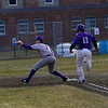 KRISTOPHER RADDER - BRATTLEBORO REFORMER<br /> Brattleboro's Kris Carroll gets Bellows Falls' McGregor Vancour out at first to turn a double play during a baseball game at Brattleboro Union High School on Monday, April 6, 2018.