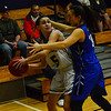 KRISTOPHER RADDER - BRATTLEBORO REFORMER <br /> Brattleboro's Megyn Ayotte looks for an open player while being covered heavily by Drury's Alison Felix during a varsity basketball game at Brattleboro Union High School on Wednesday, Jan. 24, 2018.