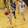 KRISTOPHER RADDER - BRATTLEBORO REFORMER <br /> Brattleboro's Megyn Ayotte takes the ball down the middle during a varsity basketball game at Brattleboro Union High School on Wednesday, Jan. 24, 2018.