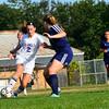 KRISTOPHER RADDER - BRATTLEBORO REFORMER<br /> Brattleboro's Rachel Rooney tries to get around Mt. Mansfield's defenders during a soccer match at Brattleboro Union High School on Monday, Sept. 11, 2017.