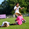 KRISTOPHER RADDER - BRATTLEBORO REFORMER<br /> Brattleboro's Axis Balsley tires to kick the ball away from Mt. Mansfield's goalie Ursula Moran during a soccer match at Brattleboro Union High School on Monday, Sept. 11, 2017.