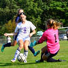 KRISTOPHER RADDER - BRATTLEBORO REFORMER<br /> Brattleboro's Rachel Rooney tries an attempt on goal before Mt. Mansfield's Ursula Moran could get the ball during a soccer match at Brattleboro Union High School on Monday, Sept. 11, 2017.