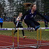 KRISTOPHER RADDER - BRATTLEBORO REFORMER<br /> Brattleboro's Mya Petrie finishes first in her heat of the 100mm hurdles during a track meet at Brattleboro Union High School on Thursday, April 12, 2018.
