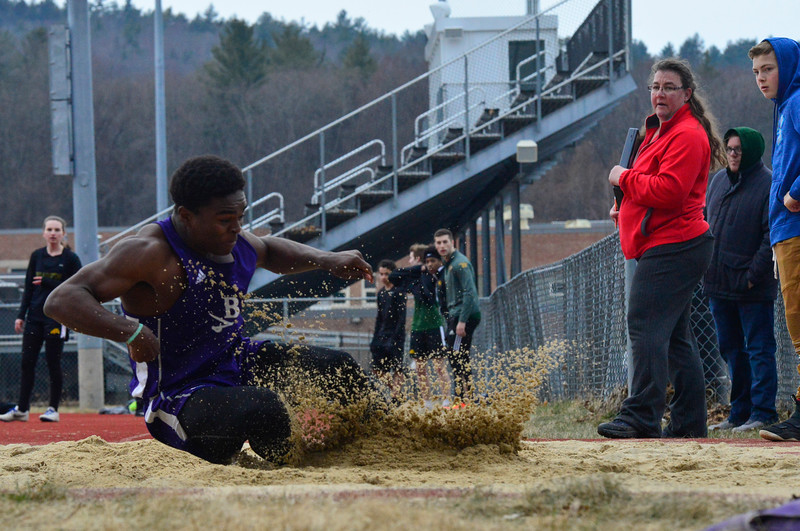 KRISTOPHER RADDER - BRATTLEBORO REFORMER<br /> Brattleboro's Jasper Reed leaps 21ft. 1in. in the long jump competition during a track meet at Brattleboro Union High School on Thursday, April 12, 2018.