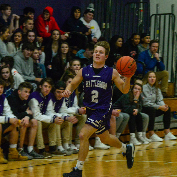 KRISTOPHER RADDER — BRATTLEBORO REFORMER<br /> Brattleboro's Tyler Millerick dribbles the ball down the court during a basketball game at Brattleboro Union High School on Wednesday, Dec. 18, 2019.