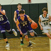 KRISTOPHER RADDER — BRATTLEBORO REFORMER<br /> Brattleboro's Greg Fitzgerald gets the defensive rebound during a basketball game at Brattleboro Union High School on Wednesday, Dec. 18, 2019.