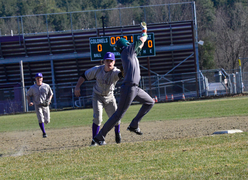 KRISTOPHER RADDER - BRATTLEBORO REFORMER<br /> Brattleboro's Kris Carroll applies the tag onto Springfield's Colin Pinney before he reaches first base during a baseball game at Brattleboro Union High School on Monday, April 23, 2018.