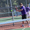 KRISTOPHER RADDER - BRATTLEBORO REFORMER<br /> Brattleboro's Jonah Peterie gets in a heated match against Amherst's Austin Xiong during a boys' tennis match at Brattleboro Union High School on Monday, April 23, 2018.