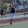 KRISTOPHER RADDER - BRATTLEBORO REFORMER<br /> Brattleboro's Martin Sipowicz hits the ball back to Amherst's James Serhant during a boys' tennis match at Brattleboro Union High School on Monday, April 23, 2018.