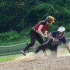 KRISTOPHER RADDER - BRATTLEBORO REFORMER<br /> Brattleboro's Jamie Mahoney slides into second as the ball gets away from Spaulding's Cassidy Whitley during a Division 1 Playdown game at Brattleboro Union High School on Thursday, May 31, 2018.
